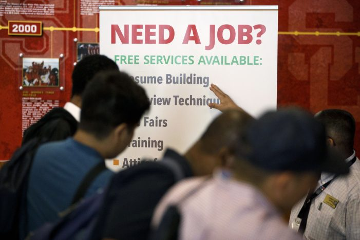 US Jobless Claims Drop to 7-Month Lows